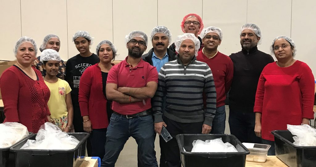 Pegasus Knowledge Solutions Feed My Starving Children Holiday Event in Chicago